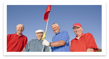 older gentlemen taking pictures with golf stick