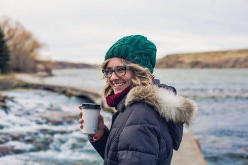 Woman Enjoying Coffee in the Fall